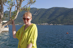A mature woman on the background of Boka-Kotor Bay Stock Photos