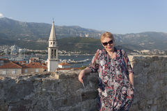 A mature woman on the background of Budva Royalty Free Stock Image
