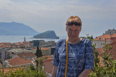 A mature woman on the background of Budva Royalty Free Stock Photos