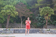 A mature woman on the background of park near the island of Svet Stock Photography