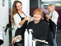 Mature woman in the barbershop Royalty Free Stock Photos