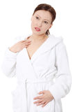 Mature woman in bathrobe Stock Images