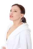 Mature woman in bathrobe Stock Photography