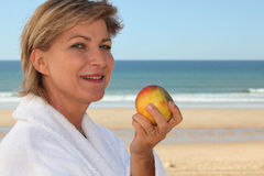 Mature woman in bathrobe Royalty Free Stock Images