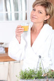 Mature woman in bathrobe Stock Photos