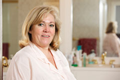 Mature woman in the bathroom Stock Image