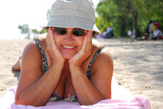 Mature woman beach stock images