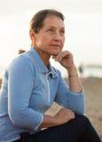 Mature woman on  beach Royalty Free Stock Image