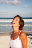Mature woman on the beach Stock Images