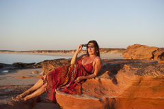 Mature Woman Beach at Sunset Royalty Free Stock Image