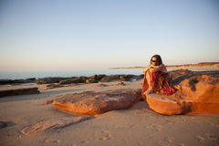 Mature Woman Beach at Sunset Stock Images