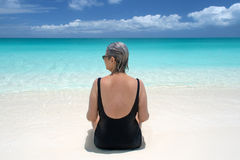 Mature woman on beach, turks and caicos Stock Photo
