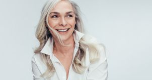 Mature woman with beautiful smile royalty free stock photos