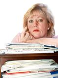 Mature woman beckoning from paper pile Stock Photography