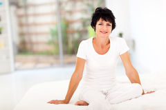 Mature woman bed stock image