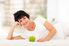 Mature woman bed Royalty Free Stock Images