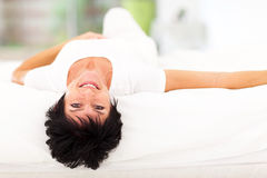 Mature woman bed Stock Photos
