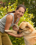 Mature woman with big  dog Stock Photos