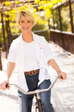Mature woman bike Stock Image
