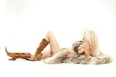 Mature woman in bikini cowboy boots Royalty Free Stock Photography