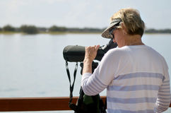 Mature woman birdwatching Stock Photo