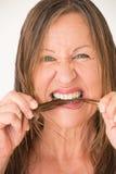 Mature woman biting hair Stock Photography