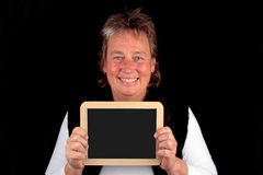 Mature woman with a black board Stock Photo