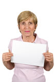 Mature woman with blank sign. Mature woman holding a blank sign isolated on white background,check also People with blank sign Stock Photography
