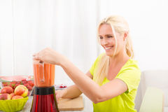 Mature woman blending a smoothie Stock Photo