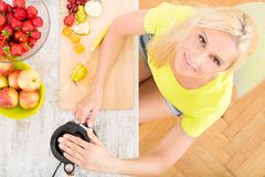 Mature woman blending a smoothie Royalty Free Stock Images