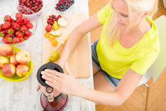 Mature woman blending a smoothie Royalty Free Stock Photo