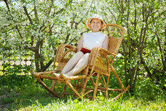 Mature woman  in blossoming garden Royalty Free Stock Photography