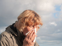 Mature Woman Blowing Nose Stock Photos