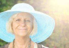 Mature woman in blue hat. Stock Photo