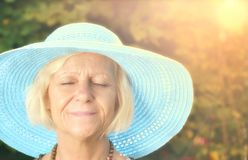 Mature woman in blue hat. Stock Image