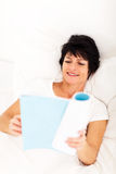 Mature woman book Stock Photo