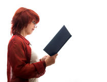 Mature woman with a book Royalty Free Stock Photos