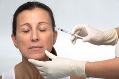 Mature woman BOTOX® Royalty Free Stock Image