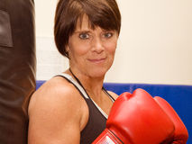 Mature Woman boxing royalty free stock photography