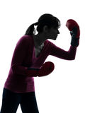 Mature woman with boxing gloves silhouette Stock Photos