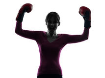 Mature woman with boxing gloves silhouette Stock Photo