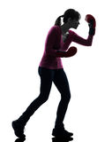 Mature woman with boxing gloves silhouette Royalty Free Stock Images
