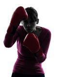 Mature woman with boxing gloves silhouette Stock Images