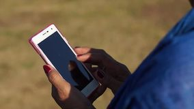 Mature woman browses internet with the use of mobile smartphone stock video