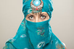 Mature woman in Burqa. On black background. Burqa is also known as Nikab, burqua and burka Stock Photography