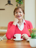 Mature woman  in   cafe. Stock Image