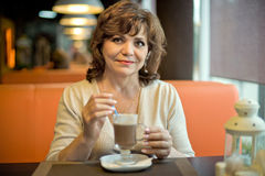 Mature woman in Cafe Royalty Free Stock Image