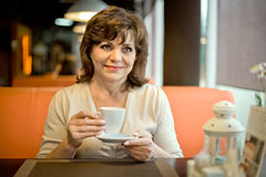 Mature woman in Cafe Royalty Free Stock Photo