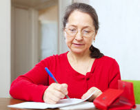 Mature woman is calculated  family budget Stock Image