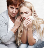 Mature woman calm young sad woman Stock Photography